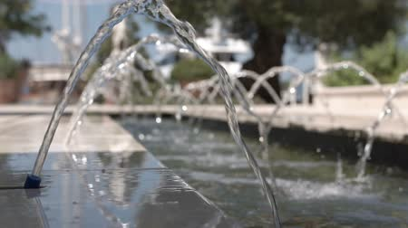 sel : Slow motion of water in a small fountain in a close-up Stok Video