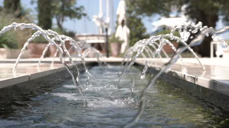 gush : Slow motion of water in a small fountain in a close-up Stock Footage