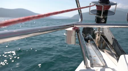 navigating : Nose part of ship on waves. Move forward on sea in great white sailing yach Stock Footage