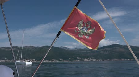 frigate : Montenegro flag flying in the wind on a yacht