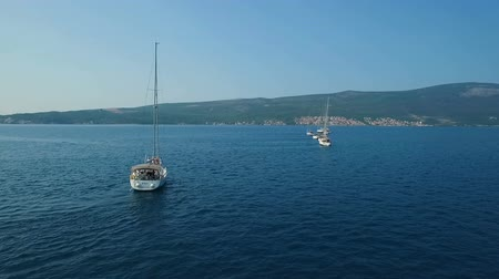 eight : Aerial. Eight yachts lined up on Adriatic sea in Montenegro