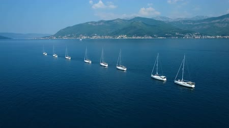 oito : Aerial. Eight yachts lined up on Adriatic sea in Montenegro