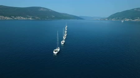 linha de costa : Aerial. Eight yachts lined up on Adriatic sea in Montenegro