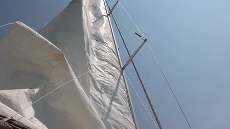 yat yarışı : Sails of the sailing yacht in the wind. White sky background