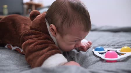 甘さ : Three month old baby lying on his stomach. Little baby boy learning to lie on a tummy and crying 動画素材