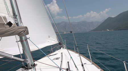 моряк : View from the nose of the yacht making the maneuver. Yacht roll