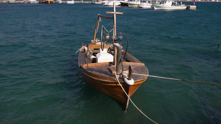 lifebuoy : Small vintage fishing boat in the marina. Stock Footage
