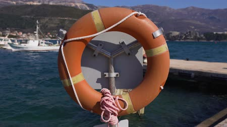 lifebuoy : Lifebuoy in the foreground. Yacht club in Montenegro.