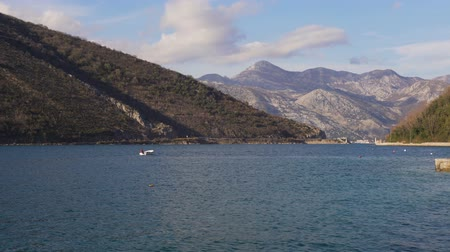моторная лодка : Fisherman on boat catching fish. On background mountains of the Kotor bay Стоковые видеозаписи
