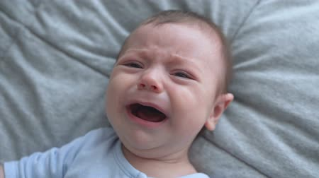 first born : Close-up of crying newborn baby.