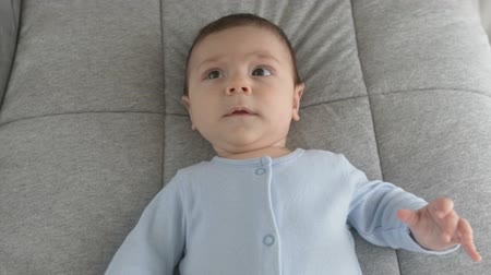 gözler : Cute baby face with brown eyes. The look of the baby in the camera close-up shot