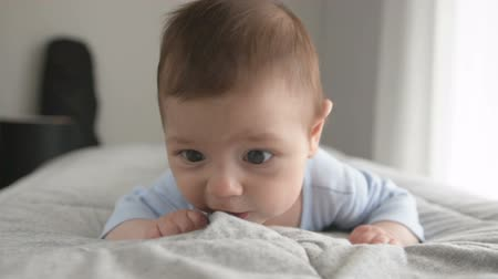 resentment : Cute baby boy three month old lying on his stomach Stock Footage