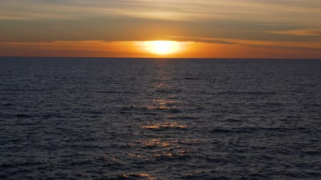 Средиземное море : Warm calm sunset over the mediterranean sea, golden light over the water Стоковые видеозаписи