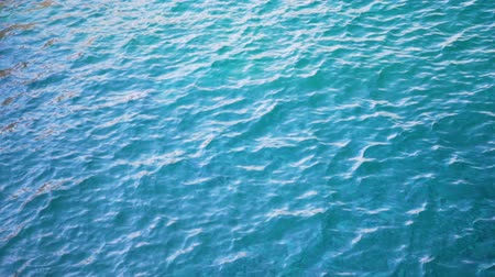 sel : Close up of disturbed blue ocean water surface. Slow motion