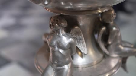 открытка : Close-up shot of the silver sculpture of the angel decorating the church. Стоковые видеозаписи