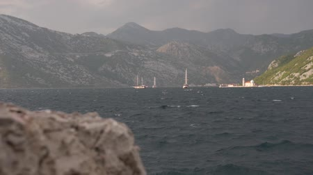 Kotor Bay, sailing yachts. Waves before the rain. 動画素材