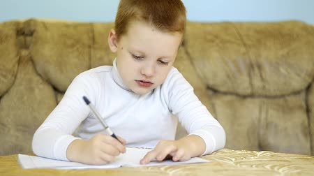 abeceda : child writing alphabet at home