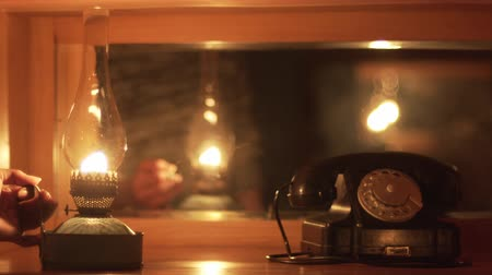 lampa naftowa : Vintage Things, Woman Puts Kerosene Lantern On A The Table