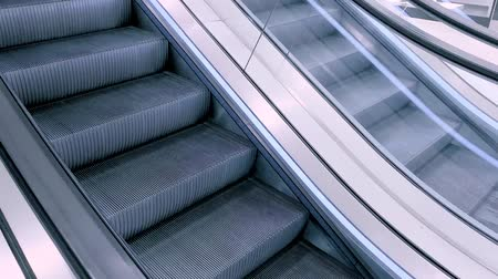 лифт : Close-up shot of empty moving staircase running up and down. Modern escalator stairs, which moves indoor - cinematic tone.