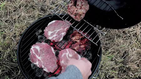 костра : Cooking delicious juicy meat steaks on the grill on fire. Summer BBQ Grill - cooked unhealthy, but very tasty grilling pork filet - close up.