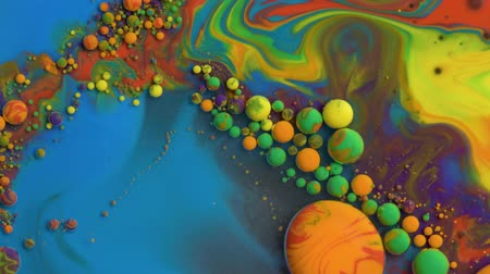 Bright colorful acrylic paint. Fantastic surface with Chaotic motion liquid. Top view. Macro structure of Multicolored Bubbles Paint and Oil.