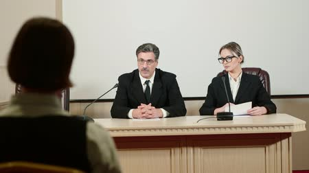 restraint : Politician with an assistant talking to journalists at a press conference. Stock Footage
