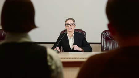 press conference : Businesswoman politician is speaking at press conference and nervous. Stock Footage