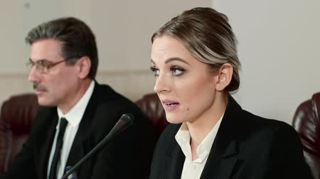 minister : Businesswoman speaker answers the journalists questions on press conference. Stock Footage