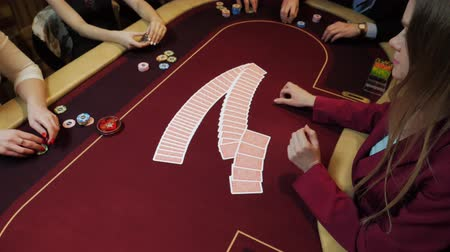 croupier : Casino: Dealer woman shuffles the poker cards on the table. Casino gamble. Slow motion.