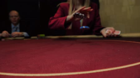 croupier : Dealer throws chips on poker table, slow motion. Chips close-up. Casino gamble.