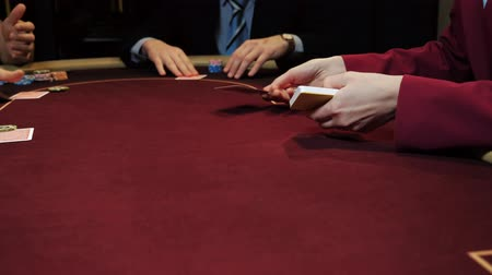croupier : Casino gamble: Dealer deals the cards to players. Cards and hands close-up.