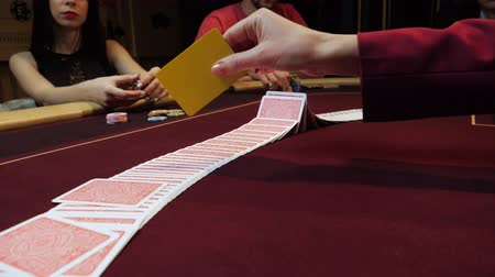 croupier : Casino: Dealer shuffles the poker cards on the table. Hands close-up. Casino gamble.