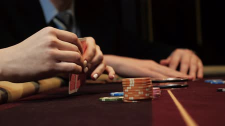 Poker player showing good card combination, ace and king on poker table. Mans hand close-up. Casino gamble. Wideo