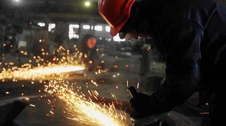 Man work with Metal processing factory. Sparks.