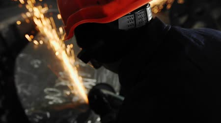 jiskry : Man work with Metal processing factory. Sparks.