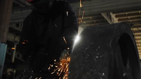 velo : Man work with Metal processing factory. Sparks.