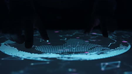 interactive table : Man rotates celestial map on the touch screen sensory interactive table. Stock Footage