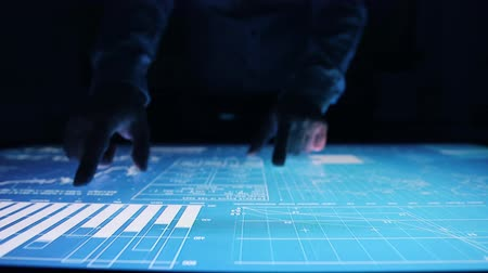 interaktif : Man works charts, diagram indicators touch screen sensory interactive table