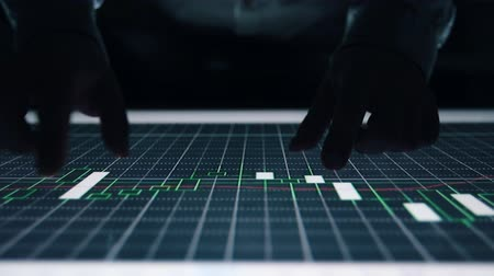 lucros : Man indicators on sensor touch screen sensory interactive table in the dark. Stock Footage