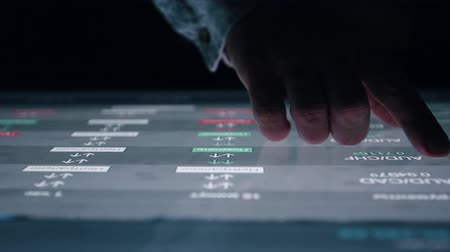 benefício : Man indicators on sensor touch screen sensory interactive table in the dark. Stock Footage