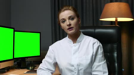 phd : Interview with a woman scientist in the office.  Green screen
