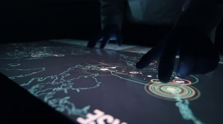 interativo : Man indicators on sensor touch screen sensory interactive table in the dark. Stock Footage
