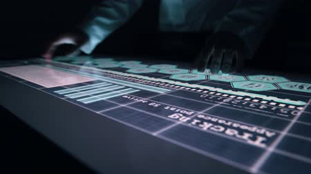 interactive table : Man indicators on sensor touch screen sensory interactive table in the dark. Stock Footage