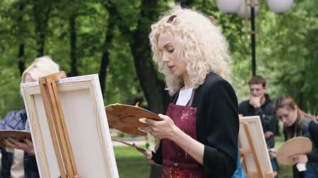 Poltava, Ukraine - may 2019: A group of women of different ages are learning to draw pictures in the park