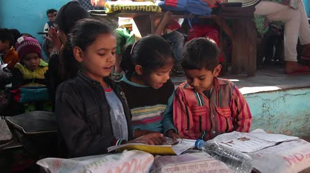 birincil : Agra, India - Circa march, 2019. Indian kids studing in local primary school.