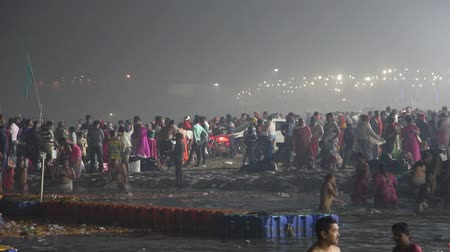 hostující : Allahabad, India - Circa March, 2019. Devotees visiting Kumbh Mela festival in Pryagraj.