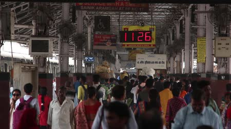 antrenör : Kolkata, India - Circa March 2019. Passengers at Howrah railway station, Kolkata, India. Stok Video