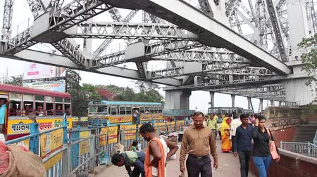 yoğunluk : Kolkata, India - Circa March 2019. Traffic at Howrah bridge.