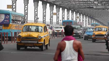 kolkata : Kolkata, India - Circa March 2019. Traffic at Howrah bridge.