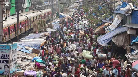 kolkata : Kolkata, India - Circa March 2019. Customers and traders of huge Mullik Ghat Flower Market on old indian street in Kolkata.